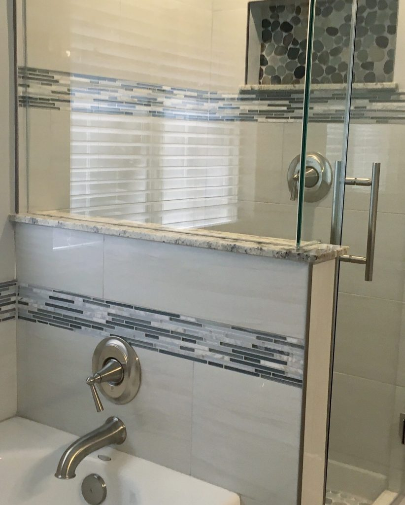 After remodel custom glass shower and tile work.
